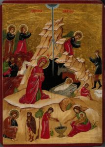 A depiction of the birth of Jesus Christ in an iconographic style.